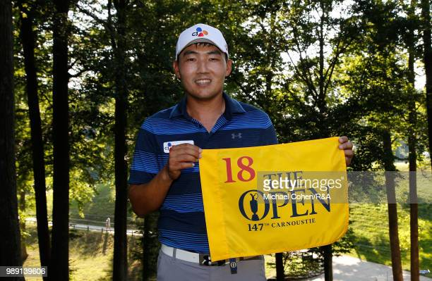 Sung Kang of South Korea holds an Open Championship hole flag after qualifying for the Open Championship during the fourth and final round of the...