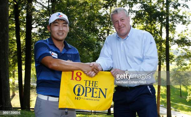 Sung Kang of South Korea is congratulated by John Clark of the RA Championship Committee after qualifying for the Open Championship during the fourth...