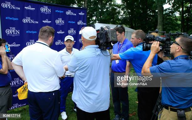 Sung Kang of South Korea is interviewed after qualifying for the Open Championship during the fourth and final round of the Quicken Loans National...