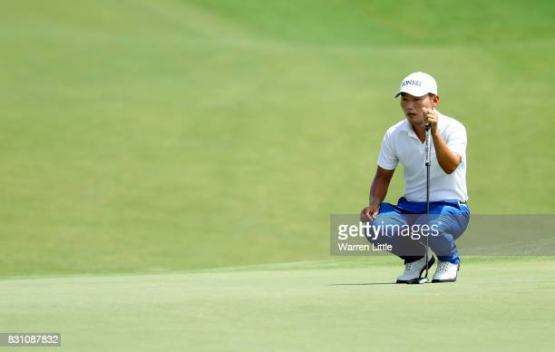 Sung Kang of South Korea lines up a putt during the final round of the 2017 PGA Championship at Quail Hollow Club on August 13 2017 in Charlotte...