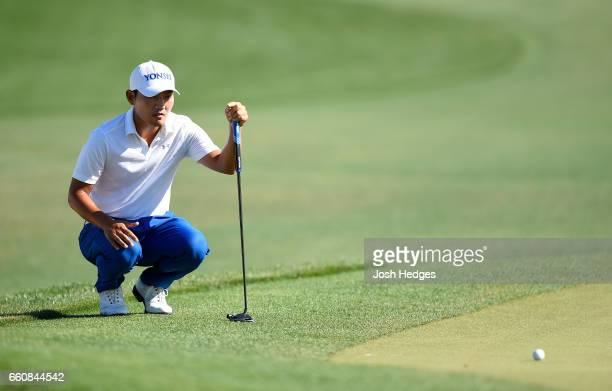Sung Kang of South Korea lines up a putt on the 18th green during the first round of the Shell Houston Open at the Golf Club of Houston on March 30...