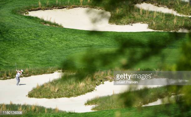 Sung Kang of South Korea plays a shot from a bunker on the fourth hole during the third round of the 2019 PGA Championship at the Bethpage Black...
