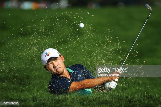 Sung Kang of South Korea plays a shot from a bunker on the tenth hole during the second round of The Northern Trust on August 24 2018 at the...