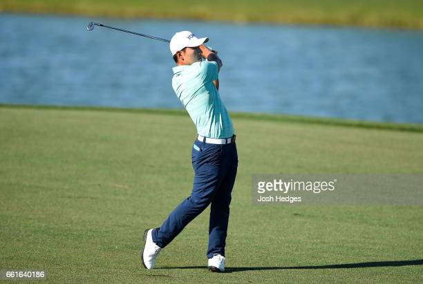 Sung Kang of South Korea plays his second shot from the fairway on the 18th hole during the second round of the Shell Houston Open at the Golf Club...
