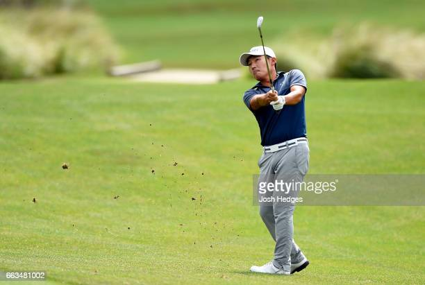 Sung Kang of South Korea plays his second shot from the fairway on the 12th hole during round three of the Shell Houston Open at the Golf Club of...