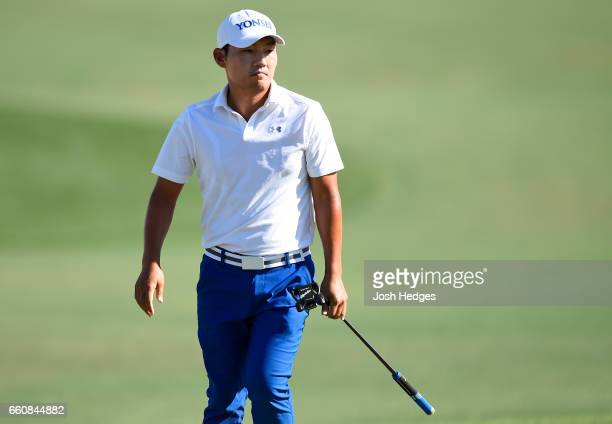 Sung Kang of South Korea reacts after missing a putt for birdie on the 18th green during the first round of the Shell Houston Open at the Golf Club...