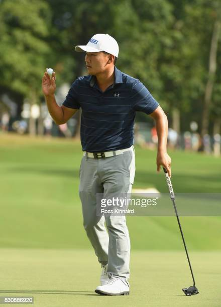 Sung Kang of South Korea reacts to his putt on the 14th green during the third round of the 2017 PGA Championship at Quail Hollow Club on August 12...