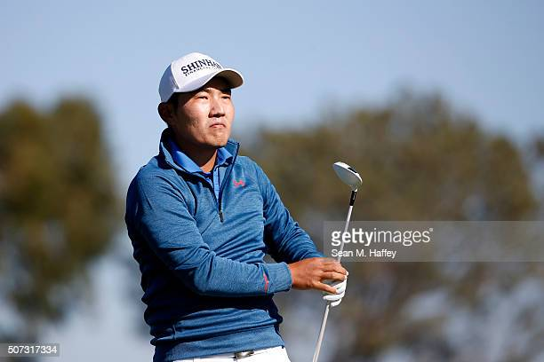 Sung Kang of South Korea tees off on the 2nd hole during Round 1 of the Farmers Insurance Open at Torrey Pines South on January 28 2016 in San Diego...