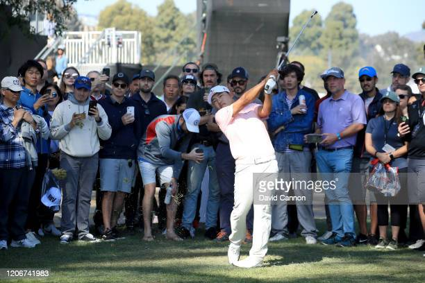 Sung Kang of the United States plays his second shot on the par 4 13th hole during the final round of the Genesis Invitational at The Riviera Country...