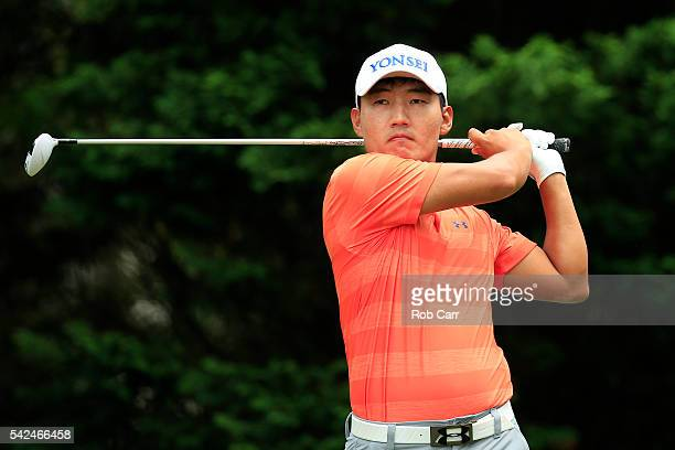 Sung Kang plays a shot from the fifth tee during the first round of the Quicken Loans National at Congressional Country Club on June 23 2016 in...