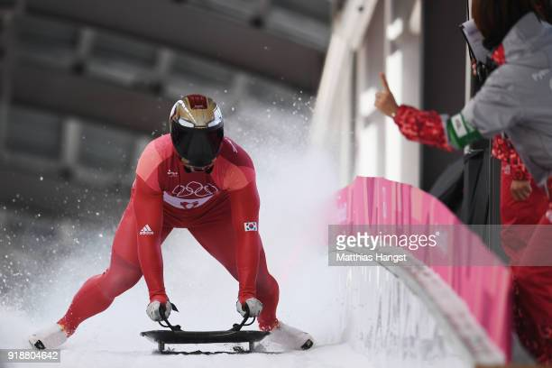 Sungbin Yun of Korea celebrates as he slides into the finish area to win the Men's Skeleton at Olympic Sliding Centre on February 16 2018 in...