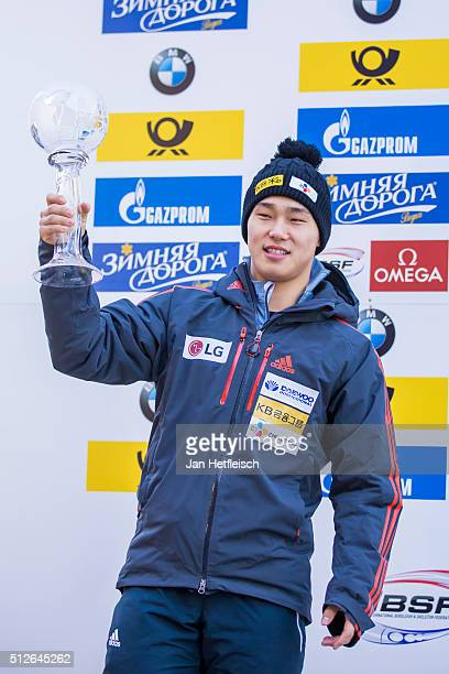 Sungbin Yun of Korea celebrates his second place of skeleton competition during IBSF Bobsleigh Skeleton World Cup on February 27 2016 in Koenigsee...