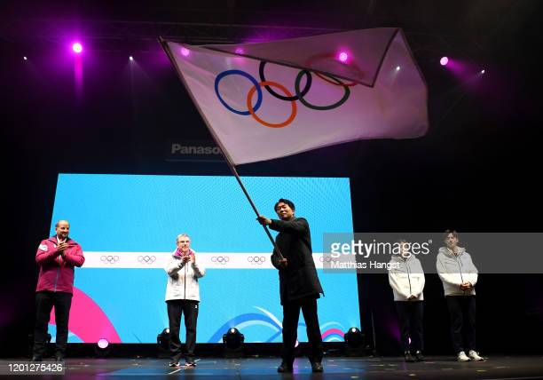 Sungho Kim, Vice-Governor of Gangwon waves the flag during the closing ceremony on day 13 of the Lausanne 2020 Winter Youth Olympics on January 22,...