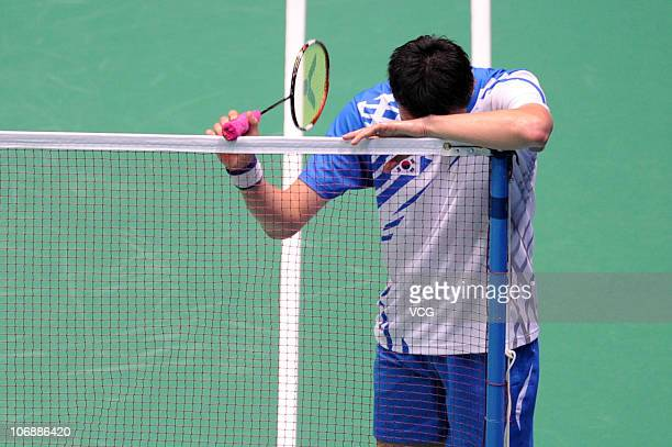 Sunghwan Park of South Korea reacts after losing a point during the men's team badminton final at Tianhe Gymnasium during day three of the 16th Asian...