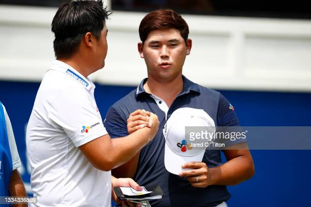 Sungjae Im of Korea and Si Woo Kim of South Korea shake hands on the 18th green during the final round of the Wyndham Championship at Sedgefield...