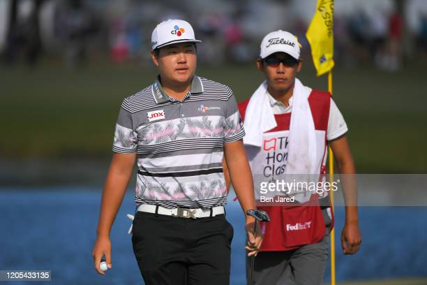 Sungjae Im of South Korea and his caddie walk off the 11th green during the final round of The Honda Classic at PGA National Champion course on March...