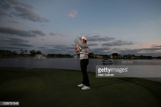 Sungjae Im of South Korea celebrates with the trophy after winning during the final round of the Honda Classic at PGA National Resort and Spa...