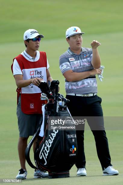 Sungjae Im of South Korea plays a shot on the sixth hole during the final round of the Honda Classic at PGA National Resort and Spa Champion course...