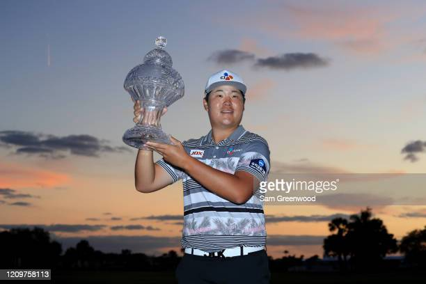 Sungjae Im of South Korea poses with the trophy after winning the Honda Classic at PGA National Resort and Spa Champion course on March 01 2020 in...