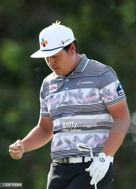 Sungjae Im of South Korea pumps his fist after a tee shot on the 15th hole during the Honda Classic at PGA National Resort and Spa Champion course on...