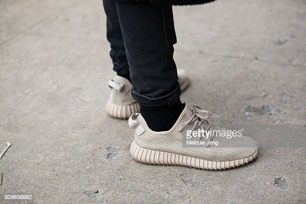 "Sungjin Park wears adidas YEEZY Boost 350 ""Oxford Tan"" sneakers during New York Fashion Week Men's Fall/Winter 2016 on February 04 2016 in New York..."