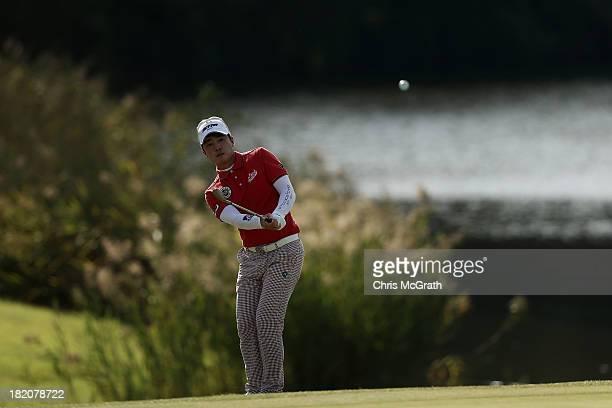 Sung-Joon Park of Korea chips pnto the 18th green during day three of the Panasonic Japan Open at Ibaraki Golf Club on September 28, 2013 in Ibaraki,...