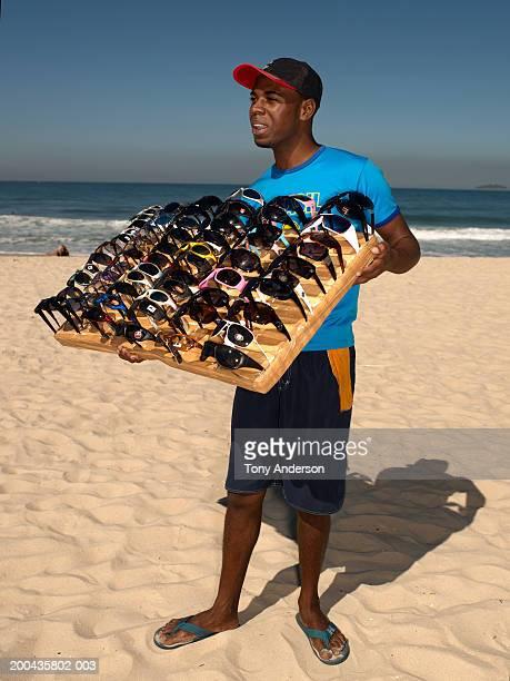 Sunglass vendor on beach