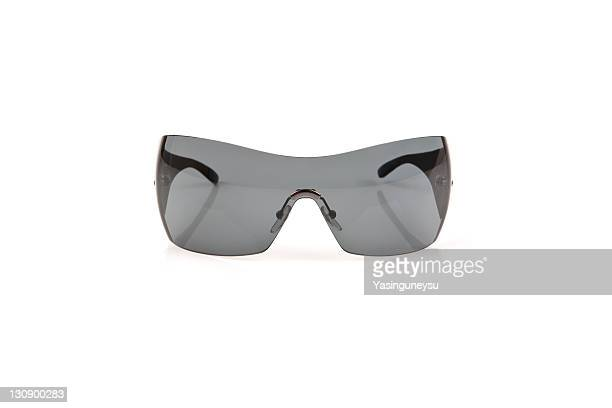 sunglasses against white background, close-up - サングラス 無人 ストックフォトと画像