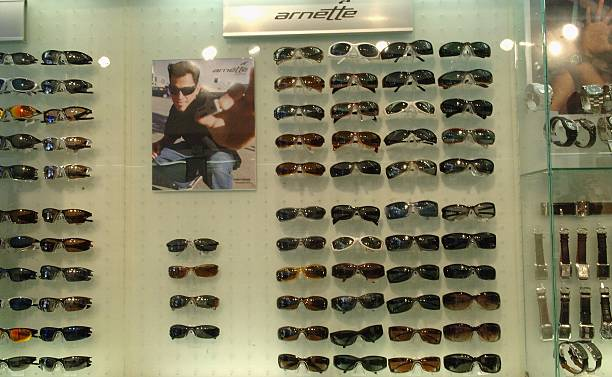 fa84ab59508f1 Sunglasses hang on display at Sunglass Hut on Lincoln Road during the Sunglass  Hut Swim Shows