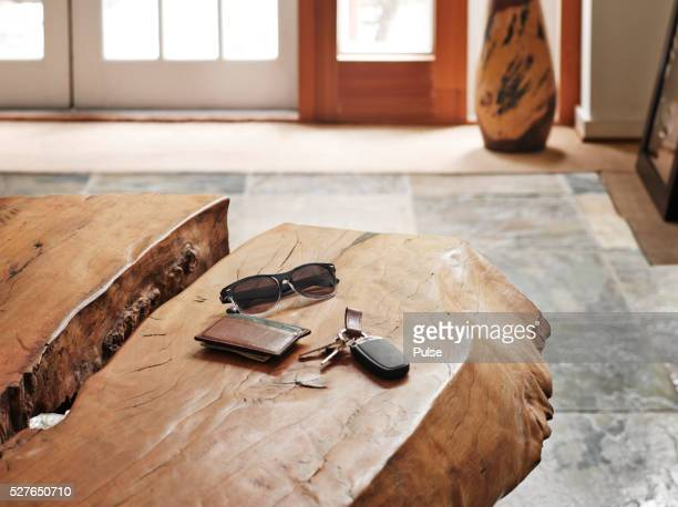 Sunglasses, keys and wallet on table