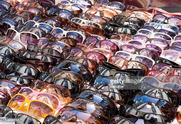 Sunglasses, lots of