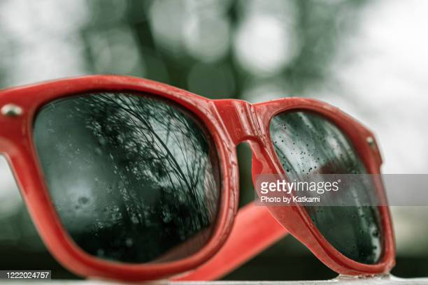 sunglasses on a rainy day - sunglasses stock pictures, royalty-free photos & images