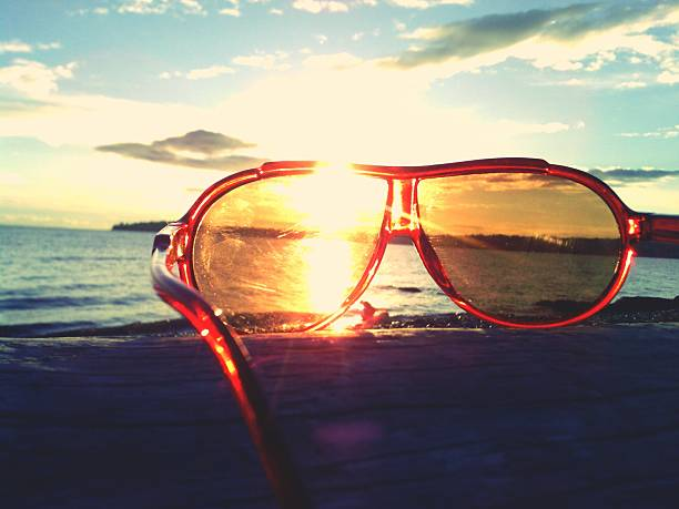 Sunglasses On Beach During Sunset Wall Art