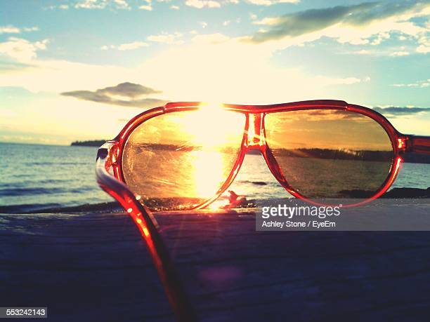 Sunglasses On Beach During Sunset