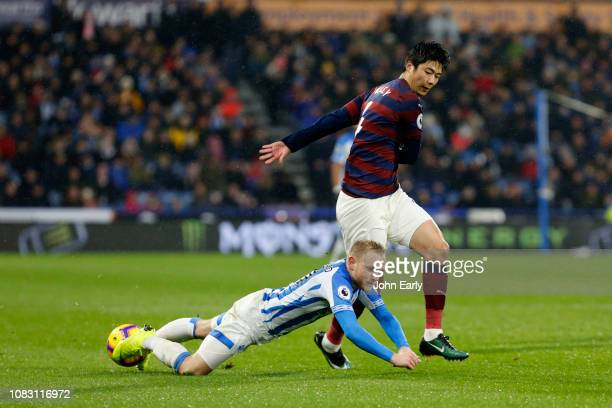 SungYeung of Newcastle United fouls Alex Pritchard of Huddersfield Town during the Premier League match between Huddersfield Town and Newcastle...