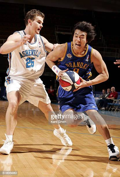 SungYoon Bang of the Roanoke Dazzle drives to the basket against Kirk Penney of the Asheville Altitude on December 7 2004 at the Asheville Civic...
