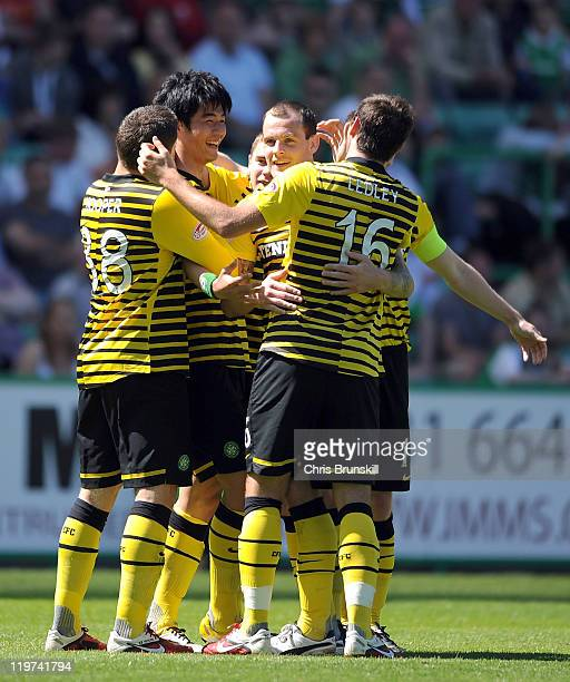 SungYueng Ki of Celtic is congratulated by teammates after scoring their side's second goal during the Clydesdale Bank Premier League match between...