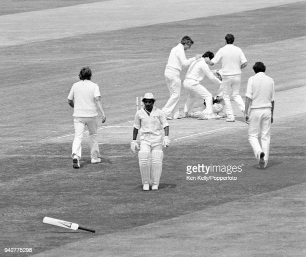 Sunil Gavaskar of India goes to retrieve his bat after being run out for 61 runs by England wicketkeeper Bob Taylor during the 1st Test match between...