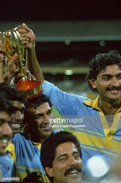 Sunil Gavaskar Ravi Shastri and Kris Srikkanth of India with the trophy after winning the Benson and Hedges World Championship of Cricket Final...