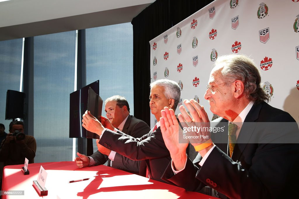 Sunil Gulati, (center) president of the United States Soccer Federation (USSF), Canadian CONCACAF President Victor Montagliani (left) and Mexican Football Federation President Decio De Maria sign a unified bid for the 2026 soccer world cup on April 10, 2017 in New York City. Canada, the United States and Mexico launched their bid to co-host the 2026 World Cup at a news conference atop the Freedom Tower in lower Manhattan. The leaders of the three country's soccer federations are seeking to host the first World Cup with an expanded 48-nation field.