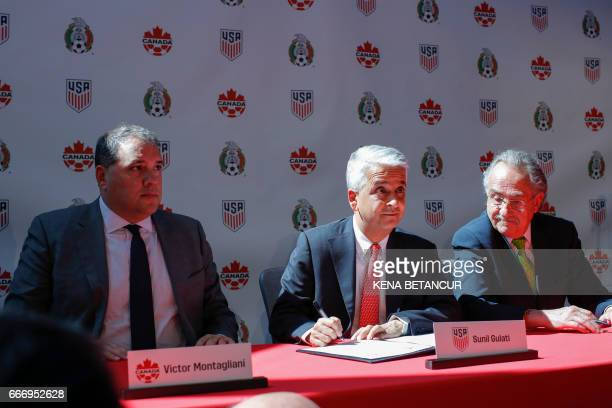 Sunil Gulati President of United States Soccer Federation signs the agreement next to Victor Montagliani CONCACAF President and Decio de Maria...