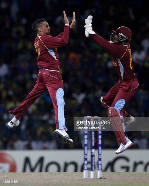 Sunil Narine and Denesh Ramdin of West Indies celebrate the dismissal of Mahela Jayawardene of Sri Lanka during the ICC World Twenty20 2012 Final...