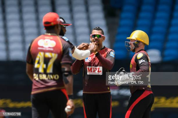 Sunil Narine and Tim Seifert of Trinbago Knight Riders celebrate the dismissal of Andre Russell of Jamaica Tallawahs during the Hero Caribbean...