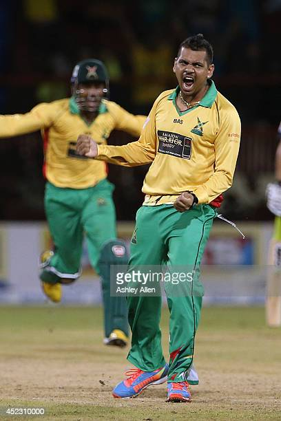 Sunil Narine celebrates after winning the match between Guyana Amazon Warriors and The Trinidad Tobago Red Steel in the Super Over as part of the...