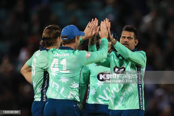 Sunil Narine of Oval Invincibles celebrates getting the wicket of Alex Hales of Trent Rockets during The Hundred match between Oval Invincibles Men...