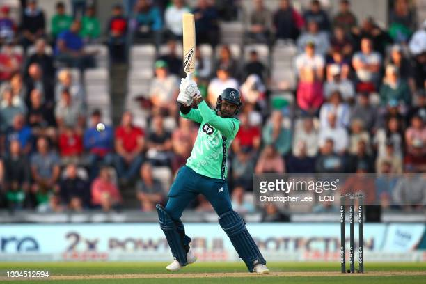 Sunil Narine of Oval Invincibles plays an attacking shot during The Hundred match between Southern Brave Men and Oval Invincibles Men at The Ageas...