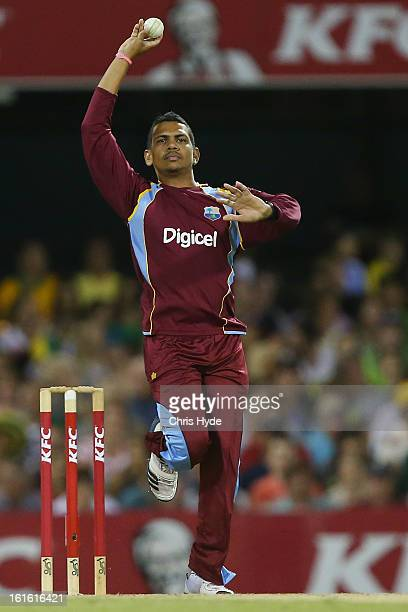 Sunil Narine of the West Indies bowls during the International Twenty20 match between Australia and the West Indies at The Gabba on February 13, 2013...