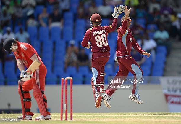 Sunil Narine of the West Indies celebrates with Denesh Ramdin after dismissing Eoin Morgan of England during the 3rd One Day International between...