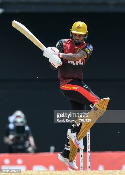 Sunil Narine of Trinbago Knight Riders hits 4 during the 2021 Hero Caribbean Premier League Play-Off match 31 between Saint Lucia Kings and Trinbago...