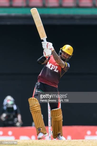 Sunil Narine of Trinbago Knight Riders hits 6 during the 2021 Hero Caribbean Premier League Play-Off match 31 between Saint Lucia Kings and Trinbago...